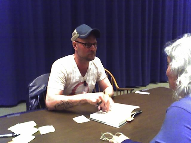 Augusten Burroughs signs books for adoring fans.